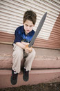 Angry Boy with a Toy Sword Royalty Free Stock Photography