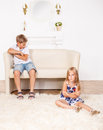 Angry brother and sister in a living room Stock Photo