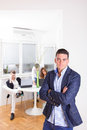 Angry business man in front of colleagues working as team lonely men pouting posing standing Royalty Free Stock Image