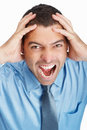 Angry business man screaming in pain Royalty Free Stock Images