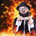 Angry business terrorist hijacking model plane artistic photo illustration of a comical bearded hyjacking a in flames and fire Royalty Free Stock Photo