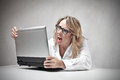 Angry business woman screaming against at her laptop Royalty Free Stock Images