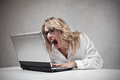 Angry business woman working at her laptop Royalty Free Stock Photos