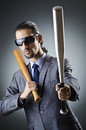 Angry businessman with bat Stock Photo