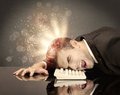 Angry businessman with lights and keyboard Royalty Free Stock Photo