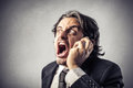 Angry businessman at the phone screaming Royalty Free Stock Image