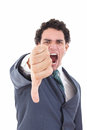 Angry businessman showing thumb down gesture as rejection symbol