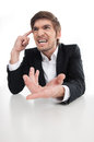 Angry businessman a young shouting and gesturing while isolated on white Royalty Free Stock Images