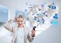 Angry businesswoman holding smartphone with cloud computing graphic digital composite of Stock Image