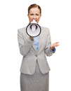 Angry businesswoman with megaphone business communication and office concept Royalty Free Stock Image