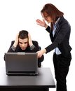 Angry businesswoman showing her emplyee the mistakes on a laptop screaming at employee and Stock Photo