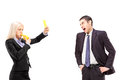 Angry businesswoman showing a yellow card to a businessman shout shouting isolated on white background Stock Image