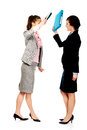 Angry businesswomen fighting with their binders. Royalty Free Stock Photo