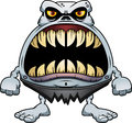 Angry cartoon ghoul a illustration of a with a big mouth full of sharp teeth Royalty Free Stock Images