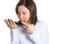 Angry cellphone conversation closeup portrait middle age mad frustrated woman yelling while on phone isolated white background Royalty Free Stock Photo