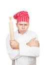 Angry chef with rolling pin Royalty Free Stock Photo