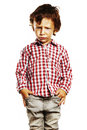 Angry child with hands in pockets Stock Images