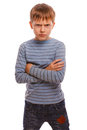 Angry child teenage boy experiencing anger blonde in a striped sweater and jeans isolated on white background Stock Images
