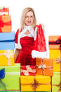 Angry christmas woman holding santa hat surrounded by presents isolated on white background Royalty Free Stock Images
