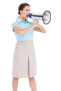 Angry classy businesswoman shouting in her megaphone on white background Stock Image