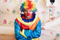 Angry clown with rainbow colored hairstyle. Royalty Free Stock Photo