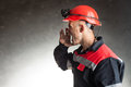 Angry coal miner shouting side view portrait of against a dark background Stock Photo