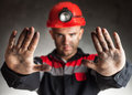 Angry coal miner shouting side view portrait of against a dark background Stock Photography