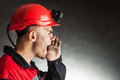 Angry coal miner shouting side view portrait of against a dark background Royalty Free Stock Image