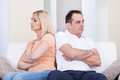Angry couple sitting on sofa Royalty Free Stock Photo