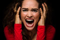 Angry desperate woman screaming close up of a very upset and Stock Images