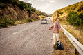 Angry and disappointed woman hitchhiker Royalty Free Stock Photo