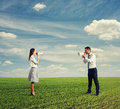 Angry emotional female and male on the field Royalty Free Stock Images