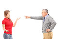 Angry father pointing at his daughter isolated on white background Stock Photo