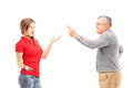 Angry father reprimanding his teenage daughter isolated on white background Stock Photography