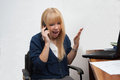 Angry female boss shouting portrait of a manager screaming and reacting angrily over the phone Royalty Free Stock Photo