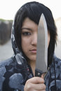 Angry Female Criminal Holding Knife Stock Images
