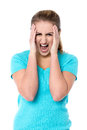 Angry female model yelling frustrated woman screaming out loud Royalty Free Stock Image