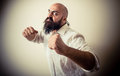 Angry fighter long beard and mustache man on gray background Royalty Free Stock Photo