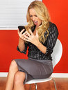 Angry Frustrated Business Woman Using a Mobile Telephone Royalty Free Stock Photo
