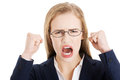 Angry and furious business woman with open mouth is screaming isolated on white Royalty Free Stock Photography