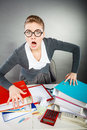 Angry furious young blonde businesswoman negative facial emotions expression expressive nervous woman emotional girl full of anger Stock Images