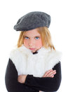 Angry gesture child sad blond kid girl portrait winter cap Royalty Free Stock Photo