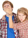 Angry girl covering her surprised boyfriend mouth Royalty Free Stock Images