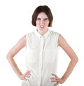 An angry girl. Disgusted girl with hands on hips. A female isolated on a white background. A brunette young woman in a blouse. Royalty Free Stock Photo