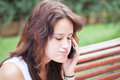 Angry girl talking on mobile phone with closed eyes. Royalty Free Stock Photo