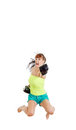 Angry girl wearing boxing gloves ready to fight and punching or pretty hitting camera you while jumps strength power Royalty Free Stock Images