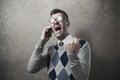 Angry guy yelling at phone Royalty Free Stock Photo
