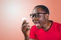 Angry handsome young man shouting while on phone closeup portrait of guy pissed off student mad worker employee unsatisfied Royalty Free Stock Photo