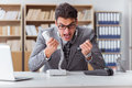 The angry helpdesk operator in the office Royalty Free Stock Photo