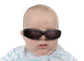 Angry kid staring through sunglasses Royalty Free Stock Images